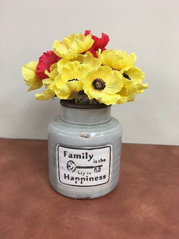 Family vase with red and yellow poppies