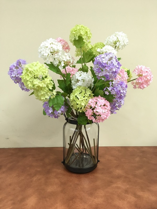 Glass vase with hydrangeas