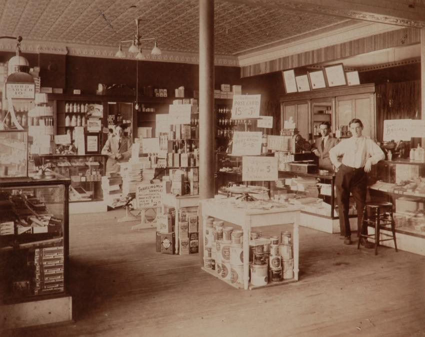 Image of AJ Hartig in the first Hartig Drug location.  Links to Hartig Drug History Page