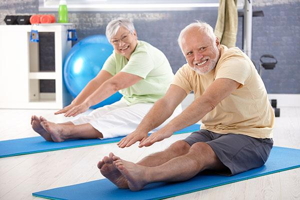 Medicare Image - Older couple at Yoga class