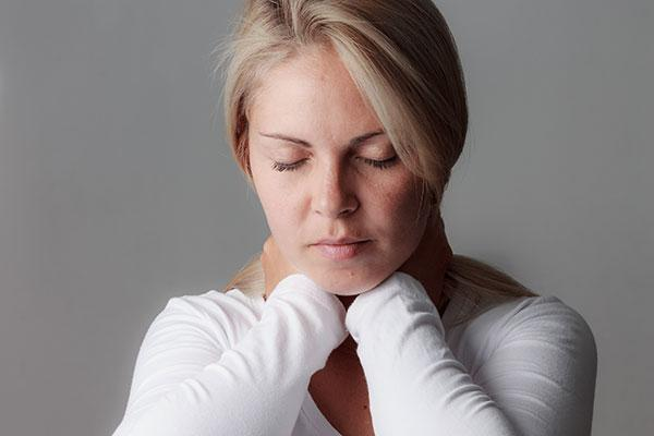 Meningitis Image - Young woman with neck pain