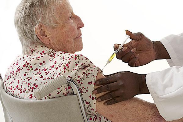 Pnuemonia Image - Elderly woman receiving shot