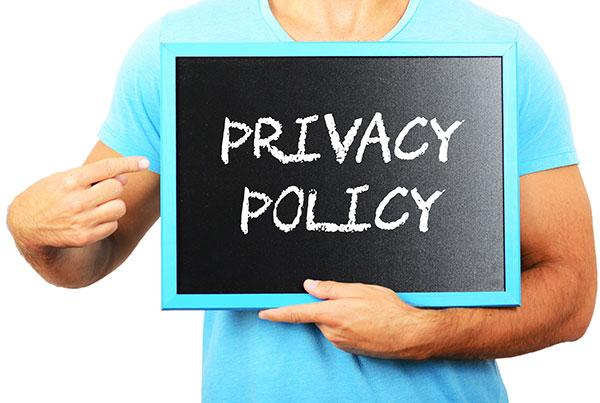 Privacy policy image - Man holding privacy policy sign