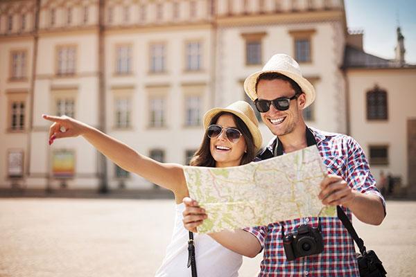 Travel Immunizations Image - Couple traveling with map